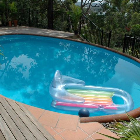 inground pool designs for sloped yards