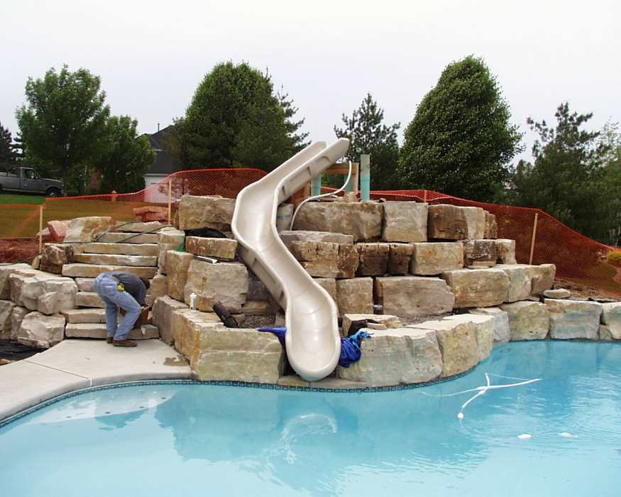 Pool slides for inground pools swimming pools photos for Above ground pool decks with slide